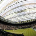 Ivan Ljubicic of Croatia serves to Andy Murray of Britain under the closed roof on Centre Court at the Wimbledon tennis championships in London